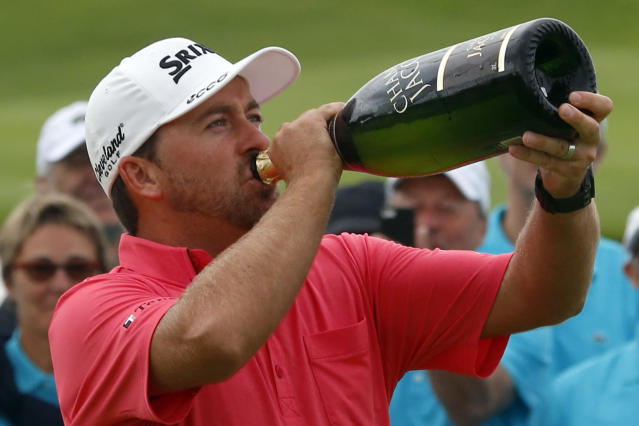 Graeme McDowell of Northern Ireland drinks champagne after winning the French Open Golf tournament at Paris National course in Guyancourt, west of Paris, France, Sunday, July 6, 2014. (AP Photo/Francois Mori)