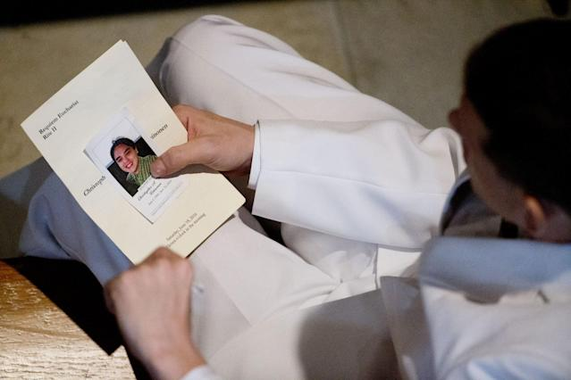 <p>A mourner looks through a program before the funeral service for Christopher Andrew Leinonen, one of the victims of the Pulse nightclub mass shooting, at the Cathedral Church of St. Luke, June 18, 2016, in Orlando, Fla.. (AP Photo/David Goldman) </p>