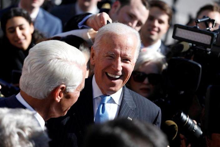 Former Vice President Joe Biden greets members of Congress after an event marking the seventh anniversary of the passing of the Affordable Care Act outside the Capitol Building in Washington, D.C., March 22, 2017. (Photo: Aaron P. Bernstein/Reuters)