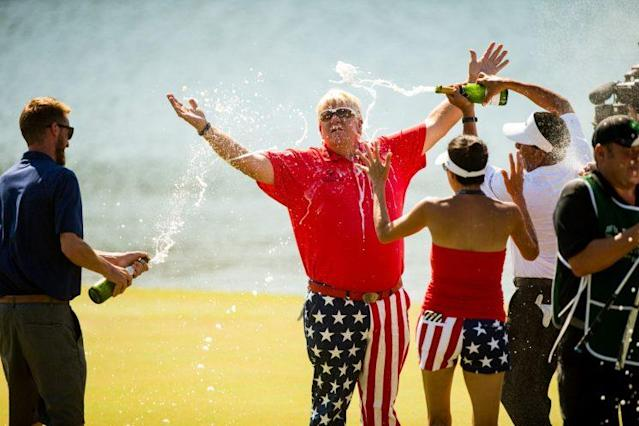 John Daly basks in a celebratory champagne shower. (Getty Images)