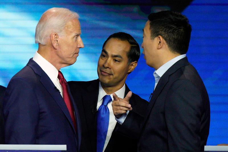 Democratic presidential candidates former Vice President Joe Biden, former Housing and Urban Development Secretary Julian Castro, and Andrew Yang talk Thursday, Sept. 12, 2019, after a Democratic presidential primary debate hosted by ABC at Texas Southern University in Houston. (AP Photo/David J. Phillip)
