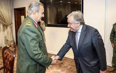 Khalifa Haftar shaking hands with United Nations Secretary General Antonio Guterres - Credit: AFP/Getty Images