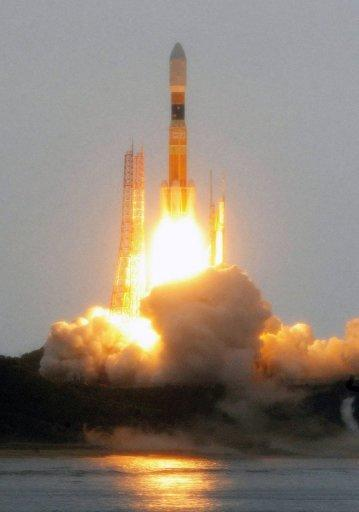 "A Japanese H-IIB rocket lifts off from the Tanegashima Space Centre in the southern island of Tanegashima on July 21. Japan participates in the International Space Station programme and launched its first lunar probe in 2007. It is planning a follow-up that it hopes will find ""organic substances or minerals containing water"" on an asteroid"