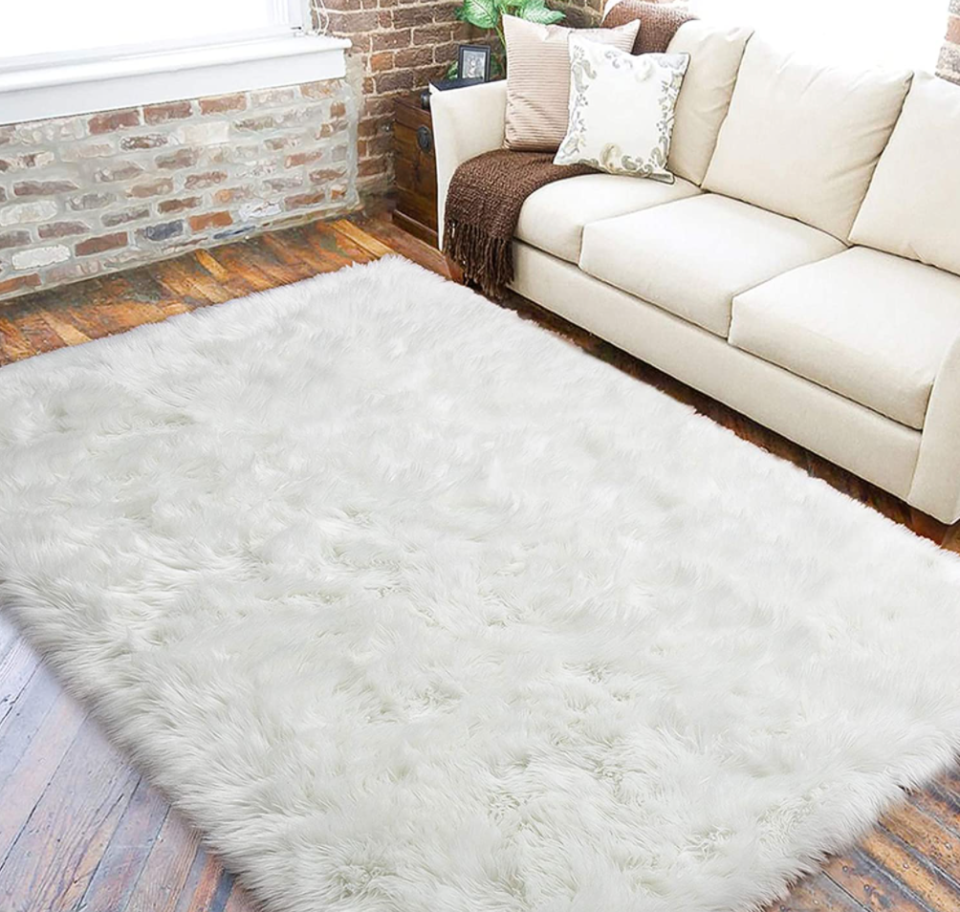 LOCHAS White Faux Fur Sheepskin Area Rug in White (Photo via Amazon)