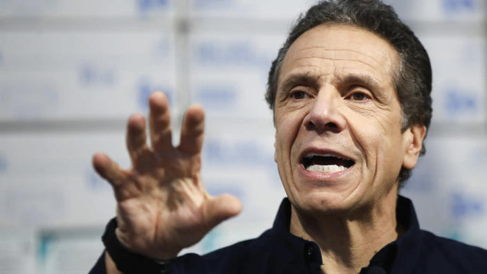 New York Gov. Andrew Cuomo speaks Tuesday against a backdrop of medical supplies at the Jacob Javits Center in New York City. (John Minchillo/AP)