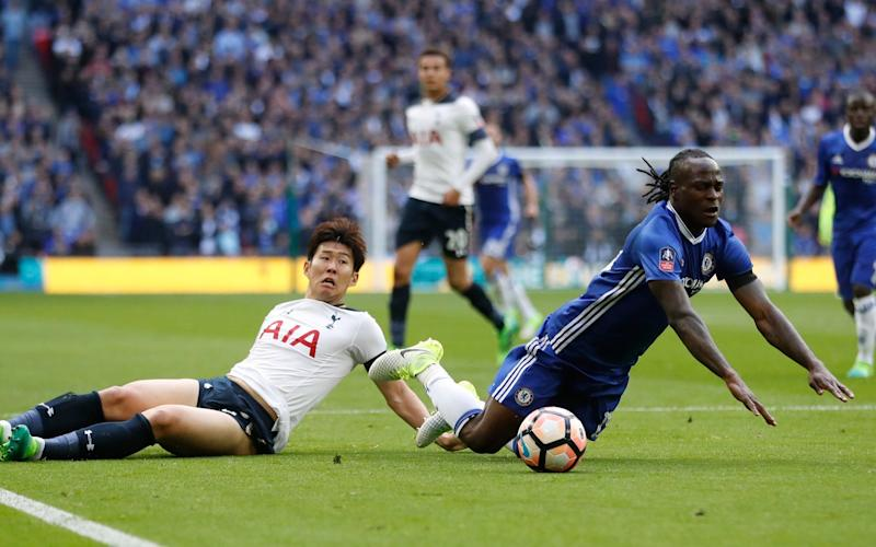 Heung-Min Son gifted Chelsea a penalty when he brought down Victor Moses just before the break - Credit: Reuters