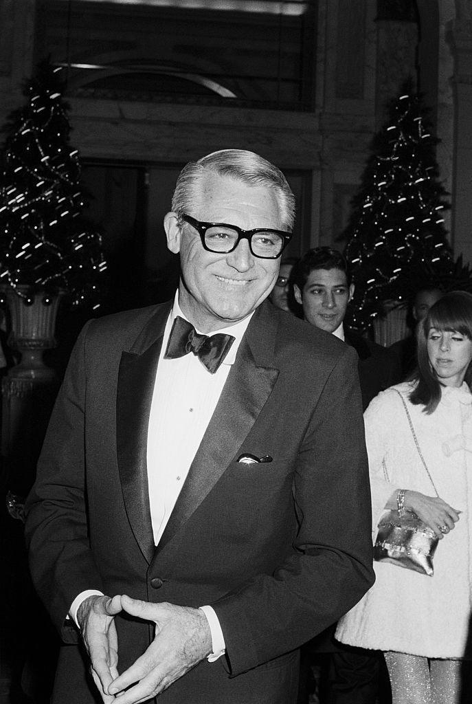 <p>Looking as sharp as ever, Cary Grant attended a festive Christmas party in New York City in 1970. The Hollywood actor wore a tuxedo fitted with a bowtie and satin lapels. </p>