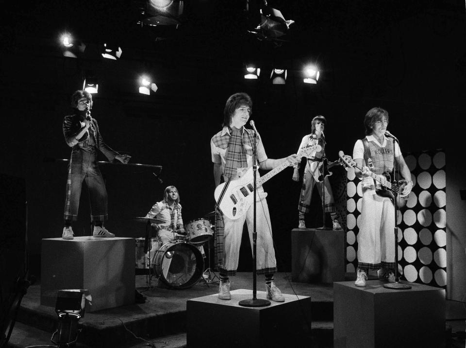 "FILE - In this Jan. 16, 1976 file photo, Scottish pop group the Bay City Rollers are seen performing during the taping of a local New York City kids' television program ""Wonderama"". McKeown, the former lead singer of 1970s pop sensation Bay City Rollers, has died suddenly at the age of 65, his family said Thursday, April 22, 2021. A statement from his family posted on social media said: ""It is with profound sadness that we announce the death of our beloved husband and father Leslie Richard McKeown."" (AP Photo/Marty Lederhandler, file)"