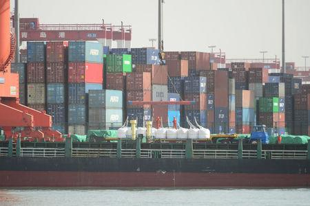A truck transporting imported raw materials of industrial chemicals is seen at a port in Qingdao