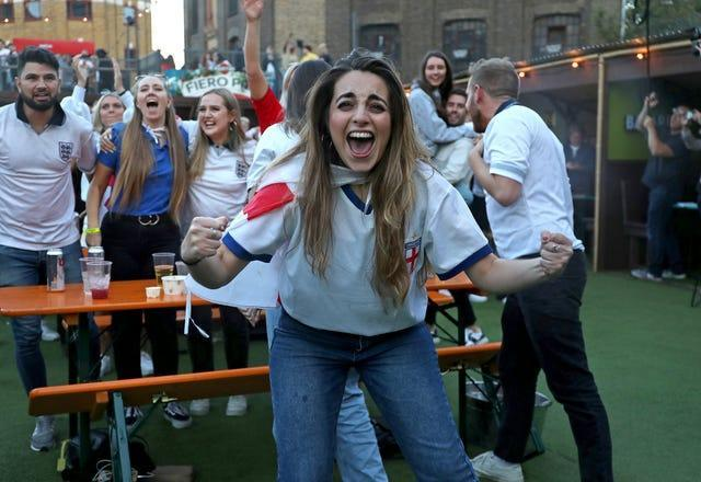 England fans celebrate at the Vinegar Yard in London