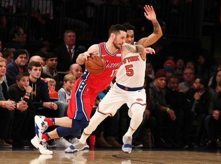 FILE PHOTO: Dec 25, 2017; New York, NY, USA; Philadelphia 76ers guard J.J. Redick (17) dribbles the ball against New York Knicks guard Courtney Lee (5) during the first half at Madison Square Garden. Mandatory Credit: Andy Marlin-USA TODAY Sports/File Photo