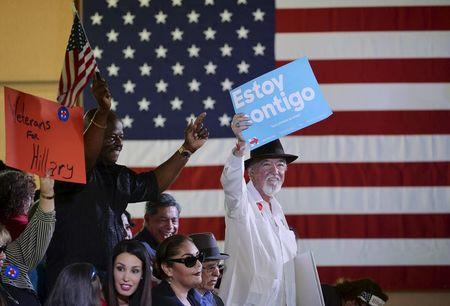 """Supporters of Democratic U.S. presidential candidate Hillary Clinton hold up signs as they wait for her to speak at a """"Latinos for Hillary"""" rally in San Antonio, Texas in this October 15, 2015, file photo. REUTERS/Darren Abate/Files"""