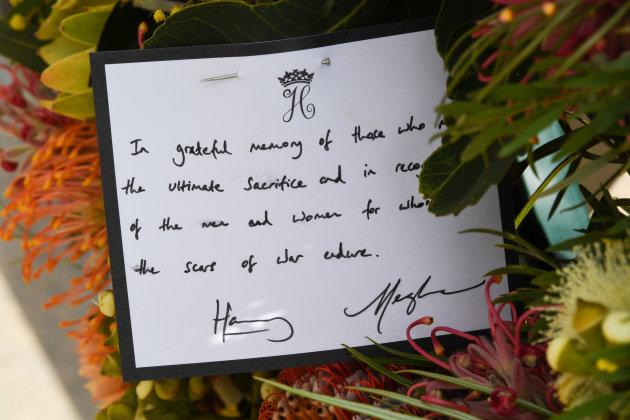 A note attached to the wreath that Harry and Meghan laid.