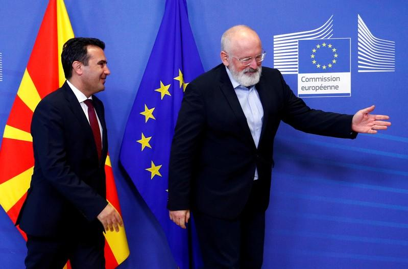 FILE PHOTO: Macedonian PM Zaev poses with EU Commission Vice President Timmermans in Brussels