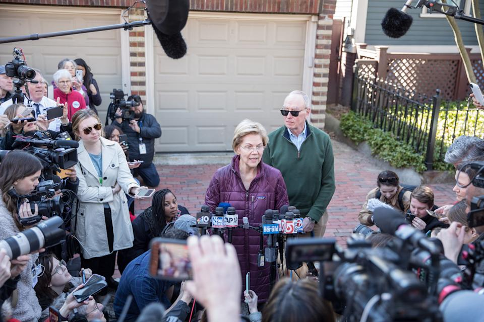 CAMBRIDGE, MA - MARCH 05:  Democratic presidential candidate Sen. Elizabeth Warren (D-MA), with husband Bruce Mann, announces that she is dropping out of the presidential race during a media availability outside of her home on March 5, 2020 in Cambridge, Massachusetts.  (Photo by Scott Eisen/Getty Images)
