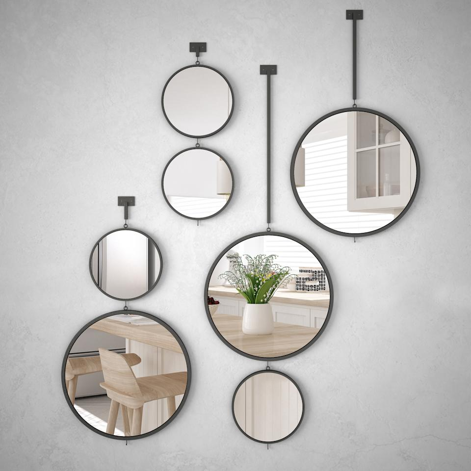Mirrors are not only helpful when you are getting ready, but work to give the illusion of a bigger space when positioned in the right place.  (Getty Images)