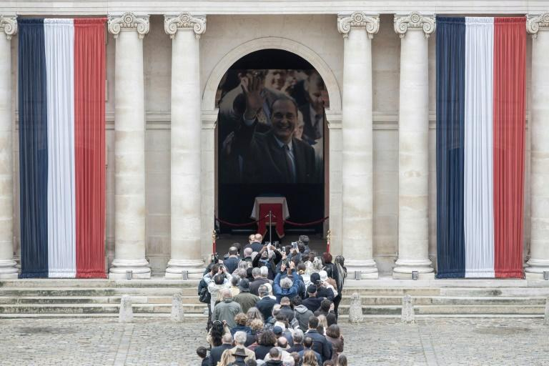 By Saturday, 5,000 people had signed condolence books at the Elysee Palace (AFP Photo/Philippe LOPEZ)