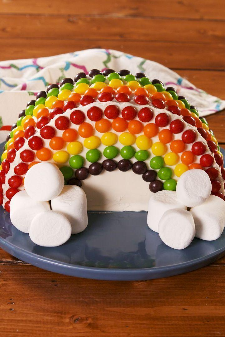 """<p>Been asked to make a rainbow <a href=""""https://www.delish.com/uk/cooking/a28783879/no-bake-birthday-cake-cheesecake-recipe/"""" rel=""""nofollow noopener"""" target=""""_blank"""" data-ylk=""""slk:birthday cake"""" class=""""link rapid-noclick-resp"""">birthday cake</a>? Or have you woken up with a craving for a Skittles covered cake? If either of these things ring true, then you're going to LOVE our <a href=""""https://www.delish.com/uk/cooking/recipes/a28827480/rainbow-swirl-cupcakes-recipe/"""" rel=""""nofollow noopener"""" target=""""_blank"""" data-ylk=""""slk:rainbow"""" class=""""link rapid-noclick-resp"""">rainbow</a> creation.</p><p>Get the <a href=""""https://www.delish.com/uk/cooking/recipes/a31222831/rainbow-cake/"""" rel=""""nofollow noopener"""" target=""""_blank"""" data-ylk=""""slk:Rainbow Cake"""" class=""""link rapid-noclick-resp"""">Rainbow Cake</a> recipe.</p>"""