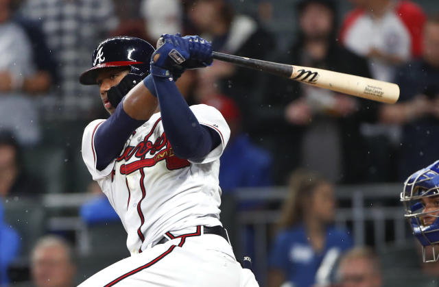 Atlanta Braves' Ronald Acuna Jr. drives in the go-ahead run with a base hit in the eighth inning of the team's baseball game against the Chicago Cubs on Wednesday, May 16, 2018, in Atlanta. The Braves won 4-1. (AP Photo/John Bazemore)