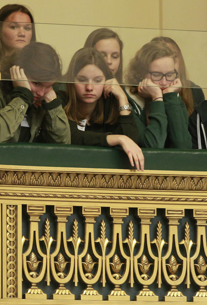 Visitors look down from the balcony onto the plenary room, as Belgian politicians gather to vote the bill on child euthanasia at the Belgian federal parliament in Brussels, Thursday Feb. 13, 2014, extending to children a legal option already possessed by the country's adults. The legislation appears to have wide support in the largely liberal country. But it has also aroused intense opposition from foes, including a list of paediatricians, and everyday people who have staged street protests. (AP Photo/Yves Logghe)