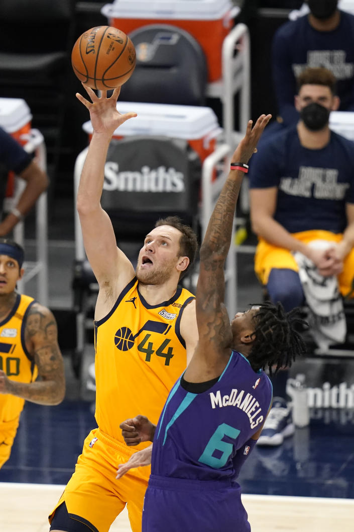 Utah Jazz forward Bojan Bogdanovic (44) lays the ball up as Charlotte Hornets forward Jalen McDaniels (6) defends in the first half during an NBA basketball game Monday, Feb. 22, 2021, in Salt Lake City. (AP Photo/Rick Bowmer)