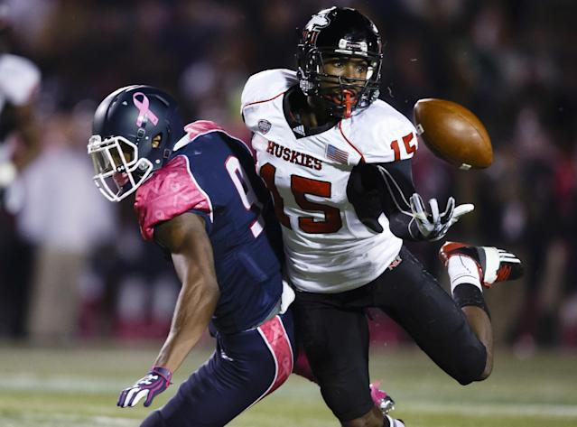 Northern Illinois safety Jimmie Ward (15) intercepts a pass intended for Toledo wide receiver Alonzo Russell (9) in the first quarter an NCAA college football game in Toledo, Ohio, Wednesday, Nov. 20, 2013. (AP Photo/Rick Osentoski)