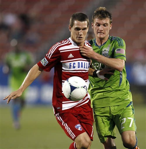 FC Dallas's Zach Loyd, left, and Seattle Sounders' Alex Caskey, chase down a loose ball in the first half of an MLS soccer game, Wednesday, May 9, 2012, in Frisco, Texas. (AP Photo/Tony Gutierrez