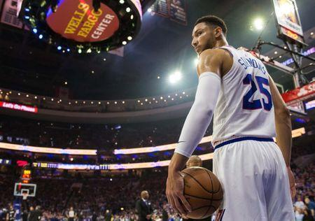 FILE PHOTO: May 5, 2019; Philadelphia, PA, USA; Philadelphia 76ers guard Ben Simmons (25) holds the ball during a timeout in the first quarter in game four of the second round of the 2019 NBA Playoffs against the Toronto Raptors at Wells Fargo Center. Mandatory Credit: Bill Streicher-USA TODAY Sports