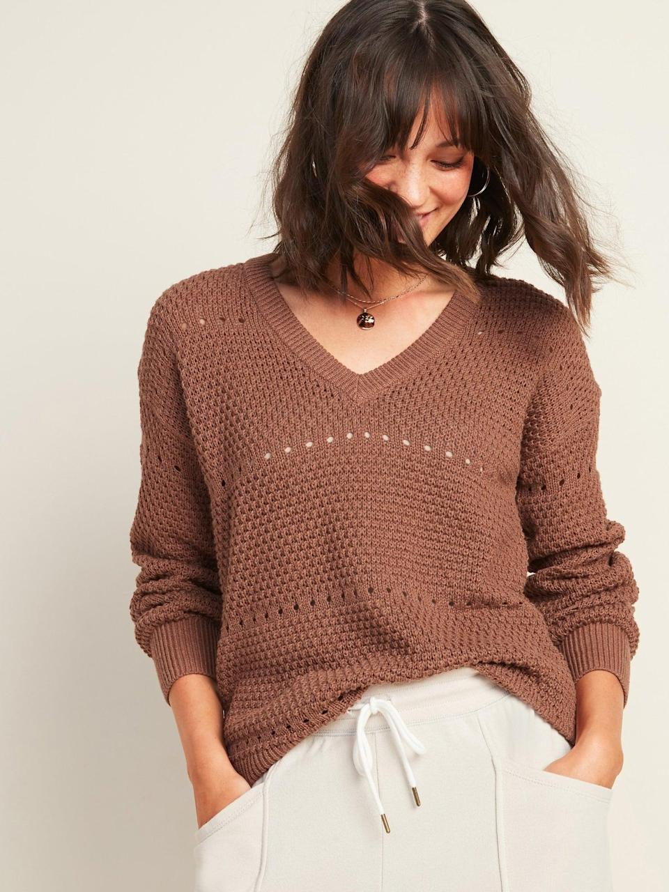 <p>The <span>Textured Pointelle-Knit V-Neck Sweater </span> ($32, originally $37) has an oversize fit and will look great tucked into trousers.</p>