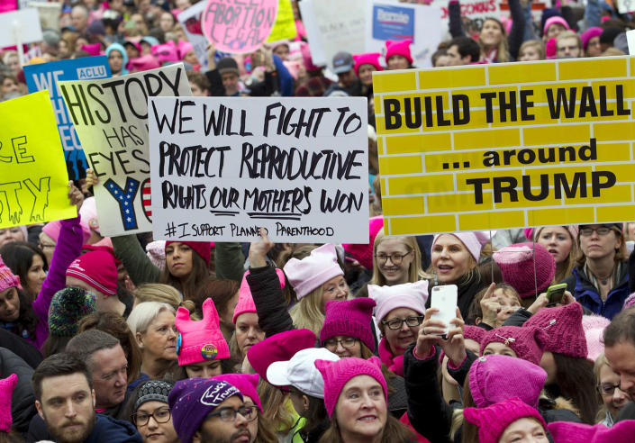 <p>Women with bright pink hats and signs begin to gather early to make their voices heard on the first full day of Donald Trump's presidency, Saturday, Jan. 21, 2017, in Washington. (AP Photo/Jose Luis Magana) </p>