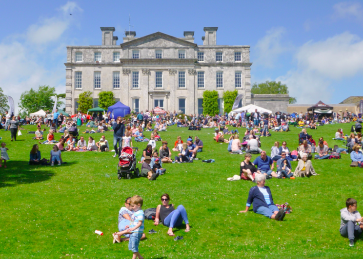 People enjoy the sun at Kingston Maurward House in Dorset on Sunday (Picture: Rex)