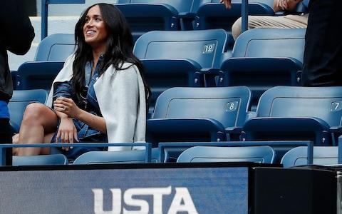 Meghan watches her friend Serena from the player's box at the US Open - Credit: Geoff Burke