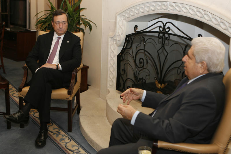 European Central Bank chief Mario Draghi, left, speaks with Cyprus President Dimitris Christofias at the Cypriot Presidential Palace on the sidelines of an informal meeting of European finance ministers in the Cypriot capital, Friday, Sept. 14, 2012. Spain appeared Friday to be inching closer to making a formal request for financial help, while Greece's euro partners gave a big hint that the heavily-indebted country may get more time, but not money, to get its public finances into shape. (AP Photo/Philippos Christou)