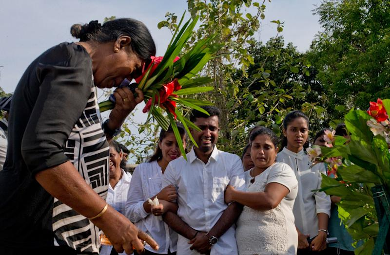 Nilanga Anthony, center, mourns the death of his seven-years old nephew Dhulodh Anthony, a victim of Easter Sunday bomb blast during the burial at Methodist cemetery in Negombo, Sri Lanka, Tuesday, April 23, 2019. (AP Photo/Gemunu Amarasinghe) ORG XMIT: XGA120