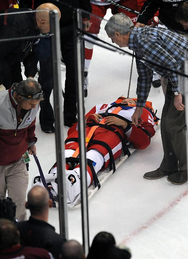 Kronwall taken off ice on stretcher after hit