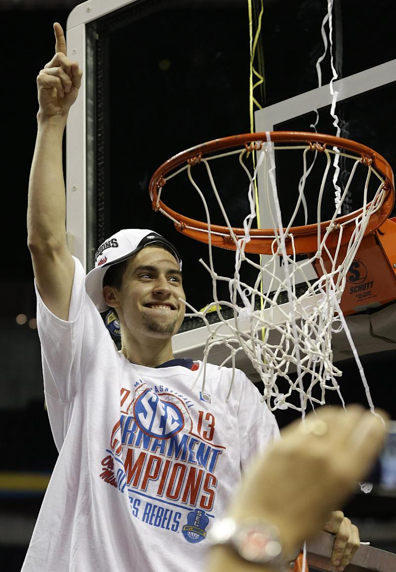Mississippi guard Marshall Henderson (22) prepares to cut part of the net after Mississippi  defeated Florida during the second half of an NCAA college basketball game in the final round of the Southeastern Conference tournament, Sunday, March 17, 2013, in Nashville, Tenn. Mississippi  won 66-63. (AP Photo/Dave Martin)