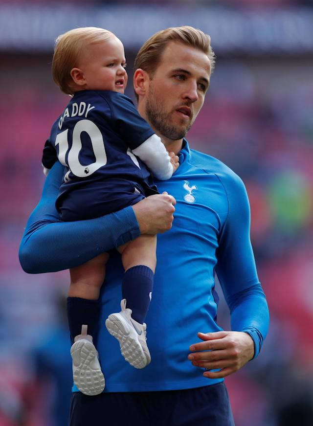 "Soccer Football - Premier League - Tottenham Hotspur vs Leicester City - Wembley Stadium, London, Britain - May 13, 2018 Tottenham's Harry Kane with his daughter on a lap of honour after the match Action Images via Reuters/Andrew Couldridge EDITORIAL USE ONLY. No use with unauthorized audio, video, data, fixture lists, club/league logos or ""live"" services. Online in-match use limited to 75 images, no video emulation. No use in betting, games or single club/league/player publications. Please contact your account representative for further details."
