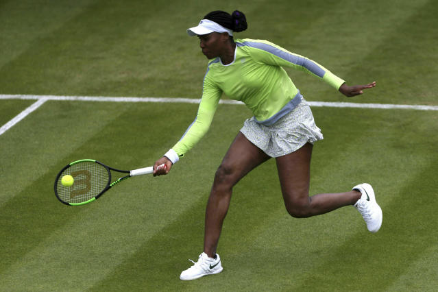 Venus Williams of the US returns a shot to Belarus' Aliaksandra Sasnovich, during day five of the Birmingham Classics, at Edgbaston Priory Club, in Birmingham, England, Wednesday June 19, 2019. (Zac Goodwin/PA via AP)