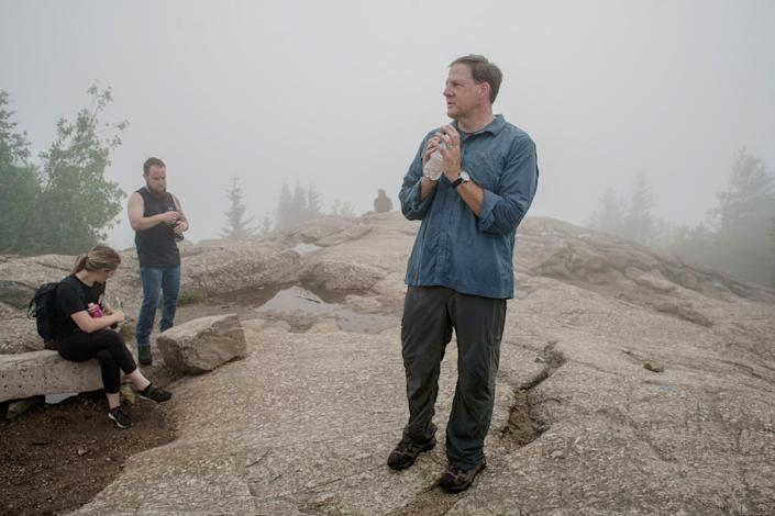 New Hampshire Gov. Chris Sununu at the summit of Mount Major in Alton, N.H., on July 15, 2021. (John Tully / for NBC News)