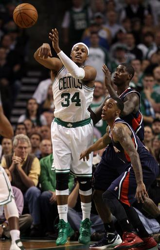 BOSTON, MA - MAY 10: Paul Pierce #34 of the Boston Celtics passes the ball as Marvin Williams #24 of the Atlanta Hawks defends in Game Six of the Western Conference Quarterfinals in the 2012 NBA Playoffs on May 10, 2012 at TD Garden in Boston, Massachusetts. The Boston Celtics defeated the Atlanta Hawks 83-80. (Photo by Elsa/Getty Images)