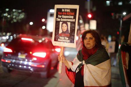 Iranian expatriate Roxanne Ganji holds a sign at a protest in Los Angeles, California U.S. January 3, 2018. Picture taken January 3, 2018. REUTERS/Lucy Nicholson