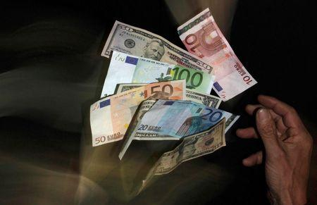 Euro and U.S. dollar banknotes are seen in this picture illustration taken in Prague
