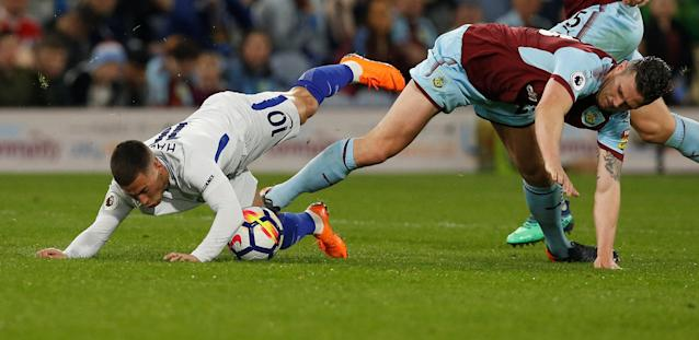 "Soccer Football - Premier League - Burnley vs Chelsea - Turf Moor, Burnley, Britain - April 19, 2018 Chelsea's Eden Hazard in action with Burnley's Kevin Long REUTERS/Andrew Yates EDITORIAL USE ONLY. No use with unauthorized audio, video, data, fixture lists, club/league logos or ""live"" services. Online in-match use limited to 75 images, no video emulation. No use in betting, games or single club/league/player publications. Please contact your account representative for further details."