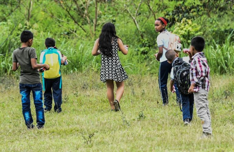Children of former FARC combatants play in Columbia's La Montanita municipality