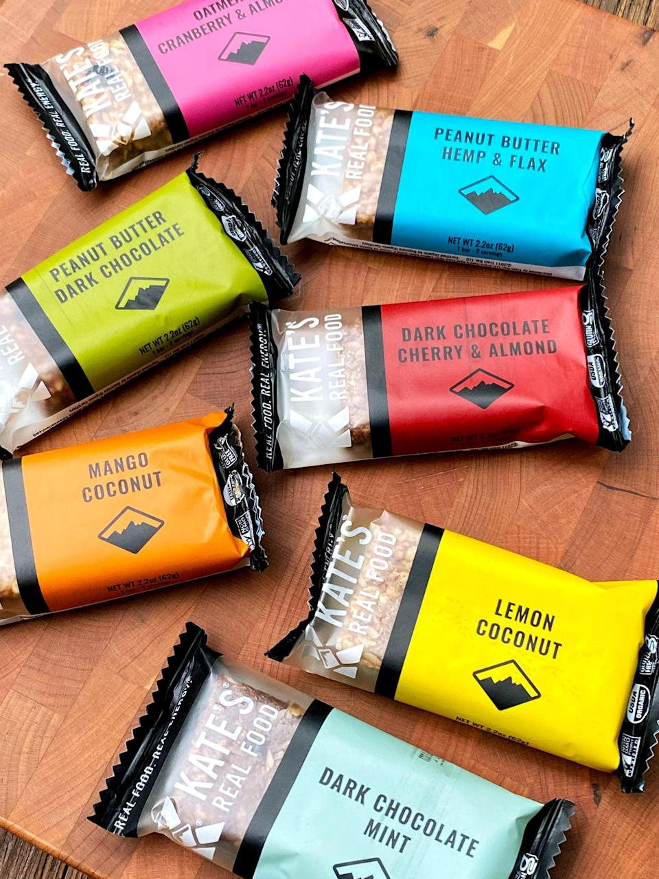 """<p>Here are the seven dairy-free flavors. I love that you can see the bars though the wrapper!</p> <p><a href=""""https://katesrealfood.com/shop/oatmeal-cranberry-almond-6-pack"""" class=""""link rapid-noclick-resp"""" rel=""""nofollow noopener"""" target=""""_blank"""" data-ylk=""""slk:Oatmeal Cranberry &amp; Almond"""">Oatmeal Cranberry &amp; Almond</a><br> <a href=""""https://katesrealfood.com/shop/peanut-butter-hemp-flax-6-pack"""" class=""""link rapid-noclick-resp"""" rel=""""nofollow noopener"""" target=""""_blank"""" data-ylk=""""slk:Peanut Butter Hemp &amp; Flax"""">Peanut Butter Hemp &amp; Flax</a><br> <a href=""""https://katesrealfood.com/shop/peanut-butter-dark-chocolate-6-pack"""" class=""""link rapid-noclick-resp"""" rel=""""nofollow noopener"""" target=""""_blank"""" data-ylk=""""slk:Peanut Butter Dark Chocolate"""">Peanut Butter Dark Chocolate</a><br> <a href=""""https://katesrealfood.com/shop/dark-chocolate-cherry-almond-6-pack"""" class=""""link rapid-noclick-resp"""" rel=""""nofollow noopener"""" target=""""_blank"""" data-ylk=""""slk:Dark Chocolate Cherry &amp; Almond"""">Dark Chocolate Cherry &amp; Almond</a><br> <a href=""""https://katesrealfood.com/shop/mango-coconut-6-pack"""" class=""""link rapid-noclick-resp"""" rel=""""nofollow noopener"""" target=""""_blank"""" data-ylk=""""slk:Mango Coconut"""">Mango Coconut</a><br> <a href=""""https://katesrealfood.com/shop/lemon-coconut-ginger-6-pack"""" class=""""link rapid-noclick-resp"""" rel=""""nofollow noopener"""" target=""""_blank"""" data-ylk=""""slk:Lemon Coconut"""">Lemon Coconut</a><br> <a href=""""https://katesrealfood.com/shop/dark-chocolate-mint-6-pack"""" class=""""link rapid-noclick-resp"""" rel=""""nofollow noopener"""" target=""""_blank"""" data-ylk=""""slk:Dark Chocolate Mint"""">Dark Chocolate Mint</a></p> <p><a href=""""https://katesrealfood.com/shop/peanut-butter-milk-chocolate-6-pack"""" class=""""link rapid-noclick-resp"""" rel=""""nofollow noopener"""" target=""""_blank"""" data-ylk=""""slk:Peanut Butter Milk Chocolate"""">Peanut Butter Milk Chocolate</a> is the only flavor that contains dairy.</p>"""