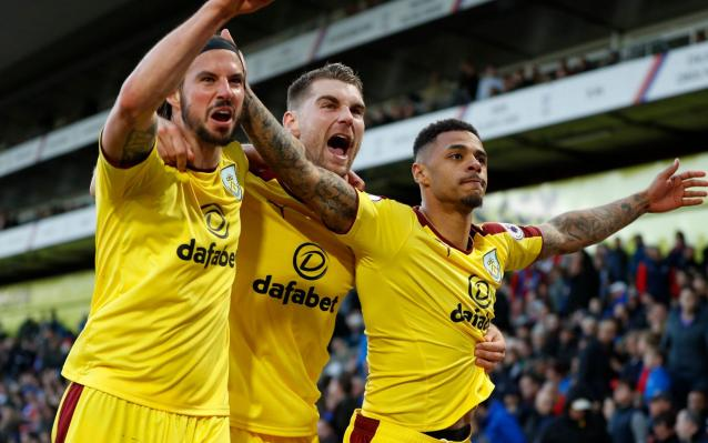 <span>George Boyd and Sam Vokes celebrate with Burnley </span> <span>Credit: Reuters </span>