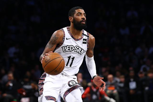 Kyrie Irving is apparently against the NBA's return. (Photo by Mike Stobe/Getty Images)