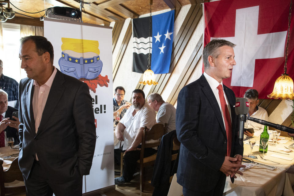SVP President and State Councillor Marco Chiesa, TI, on the right, and National Councillor Thomas Matter, BL, speak about the limitation initiative on Sunday, 27 September 2020 in Rothrist, Switzerland. The Swiss electorate has to decide on five Swiss proposals (Peter Schneider/Keystone via AP)