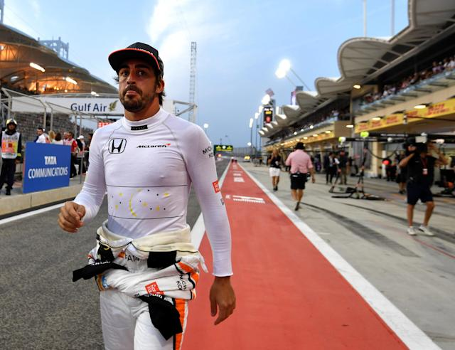 McLaren's Spanish driver Fernando Alonso walks on the pit lane ahead of the Bahrain Formula One Grand Prix at the Sakhir circuit in Manama on April 16, 2017. (AFP Photo/ANDREJ ISAKOVIC)