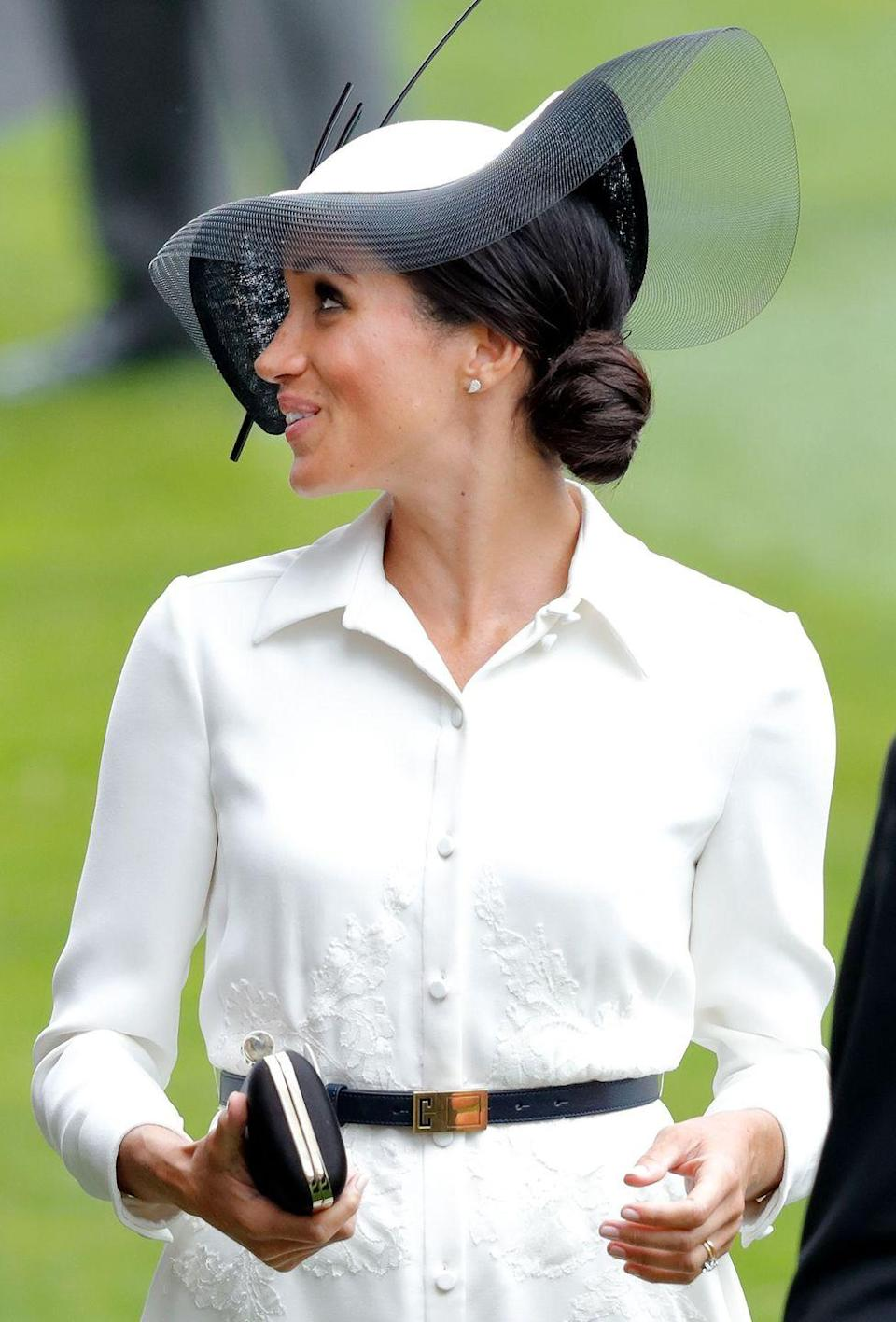 <p>An elegant side bun is the perfect style for under a large hat or fascinator.</p>
